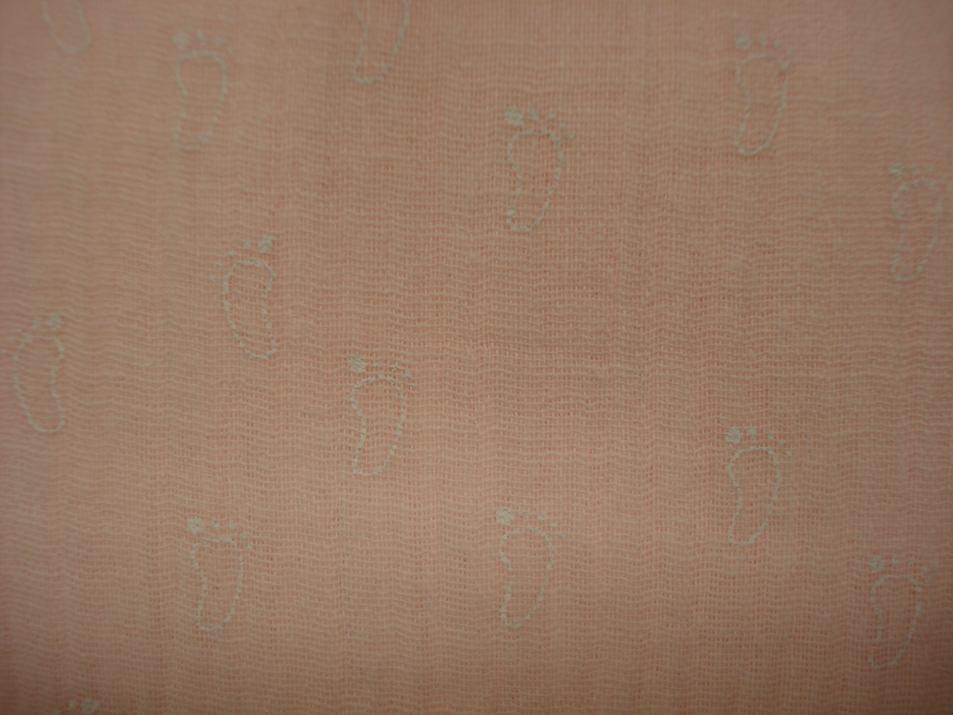 Hydrofiel katoen babyroze met witte voetjes print