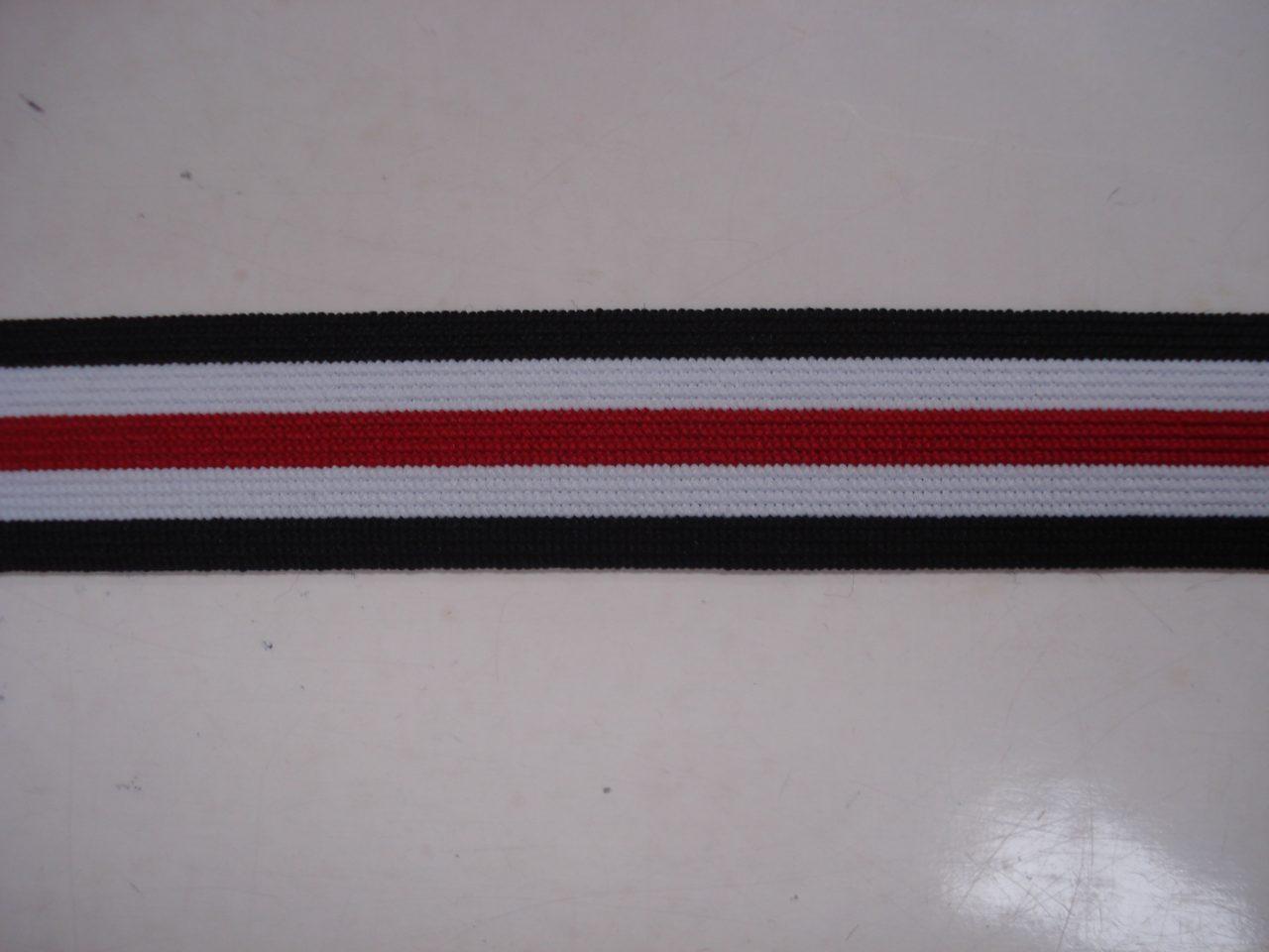 Gestreept Elastiek zwart/wit/rood 25mm. halve meter €0,98.