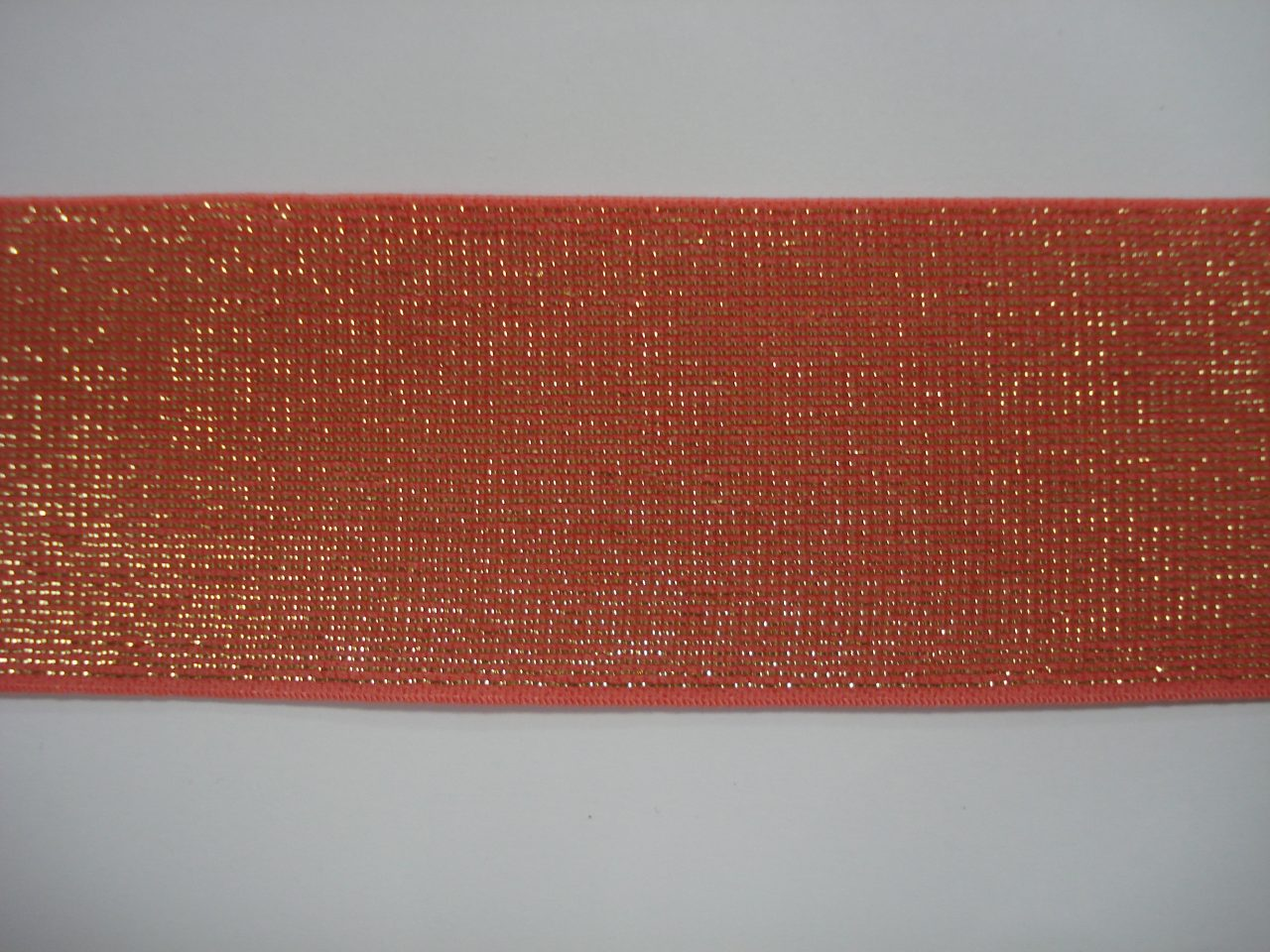 Glitter Elastiek 40mm koraal/goud €3,50 p/m