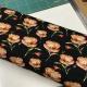 katoenen tricot zwart met roosjes € 10,00 p/m