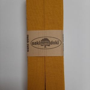 tricot biasband oker 950